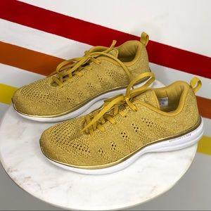 APL techloom pro 24k gold sneakers women's 9.5